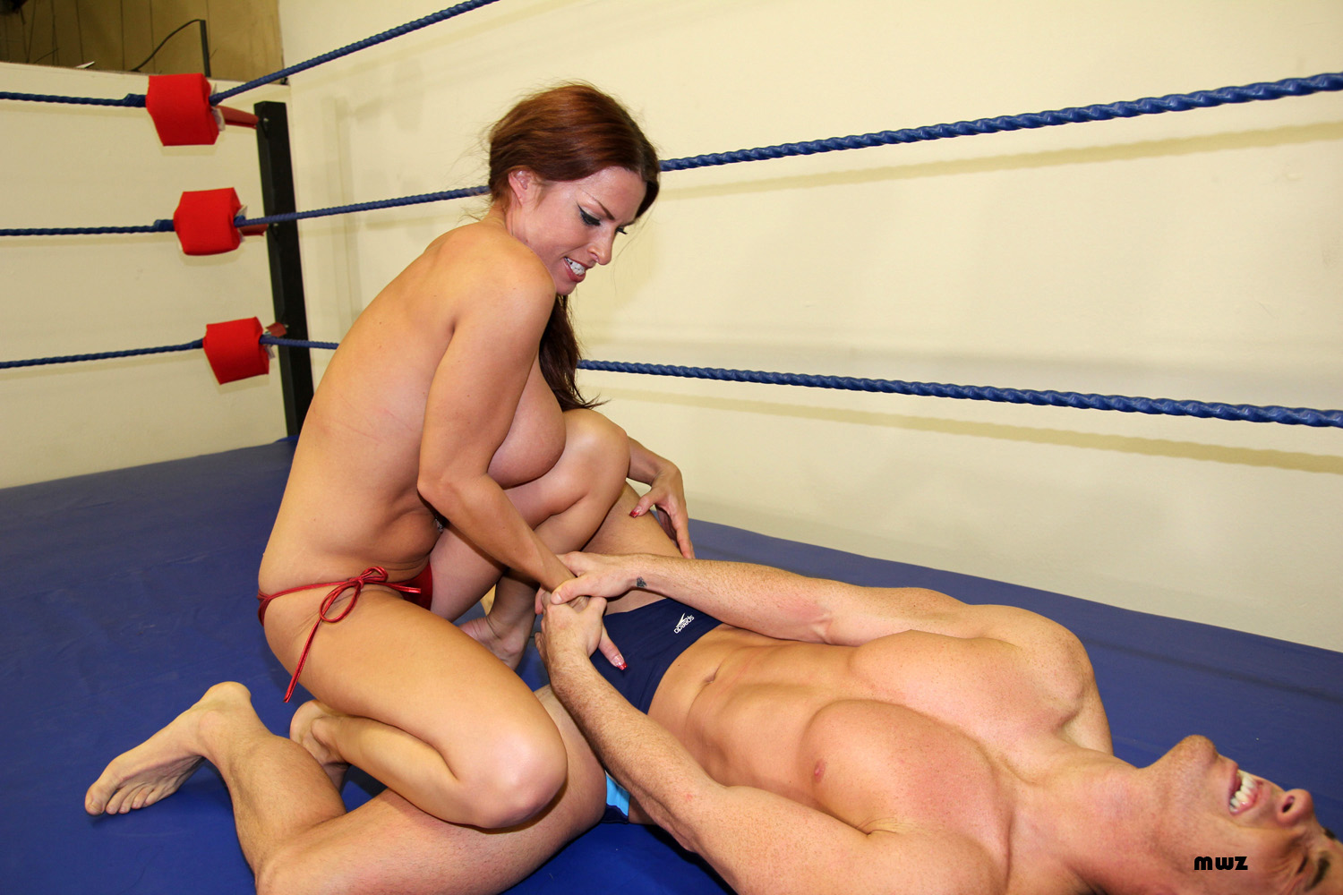 Mixed wrestling and ballbusting
